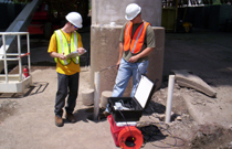 Engineers using Length Inductive Test Equipment